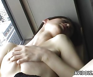 Solo session where the Asian babe rubs on her wet cunt