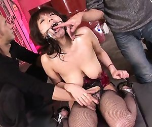 Busty Asian babe gets her huge tits creamed good by two...