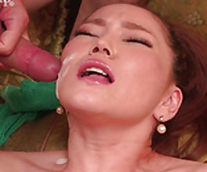 Stunning milf getting her face cummed on